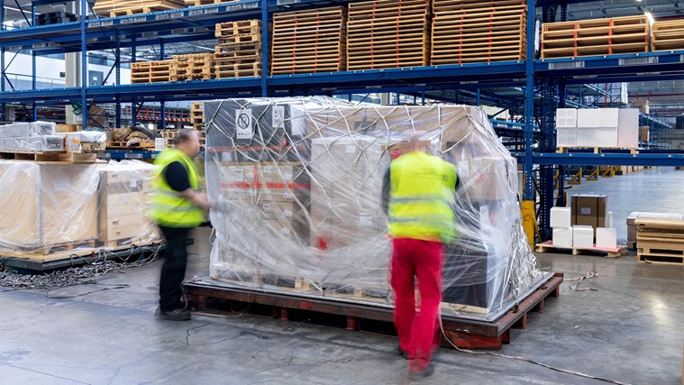 Employees preparing freight